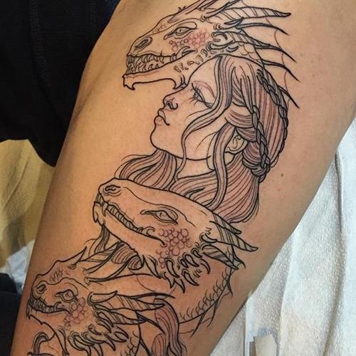 Татуировка дракона на руке